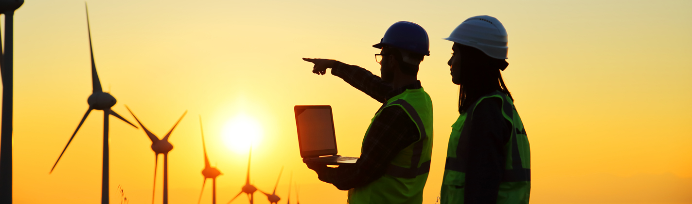 Workers in front of Wind Turbines