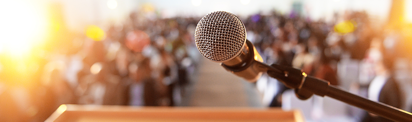 Microphone at podium in front of crowd