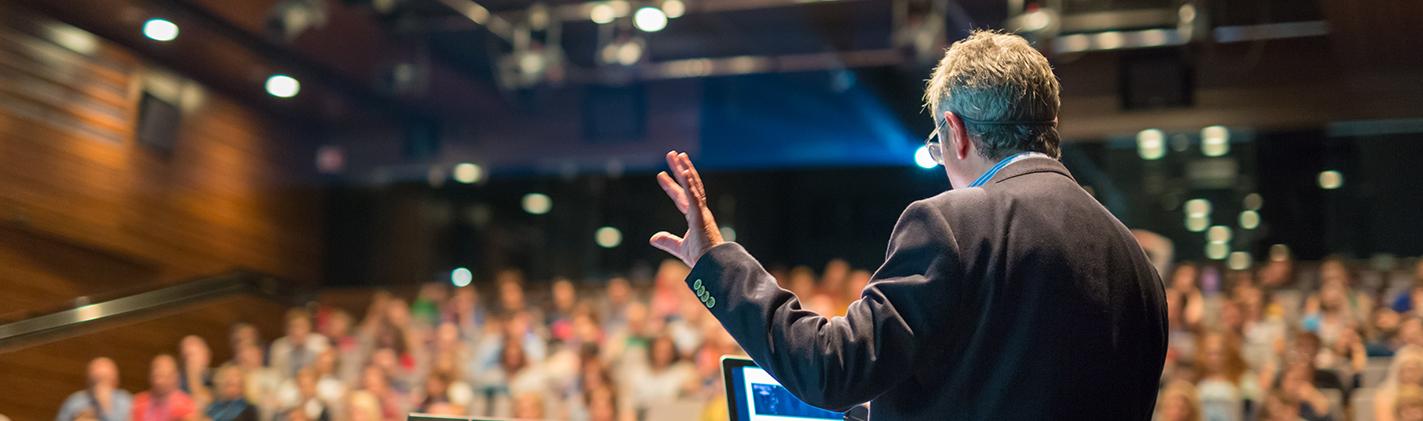 Man giving talk in auditorium