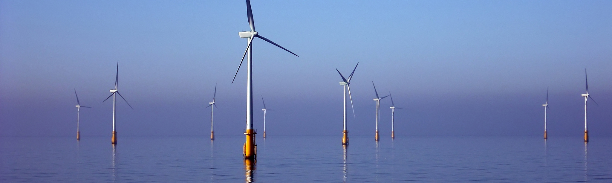 Wind turbines in an ocean, supporting sustainability