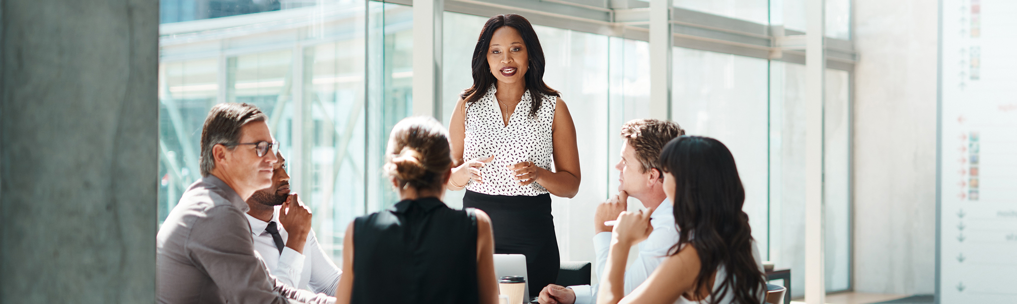 Woman talking to diversity in communications group